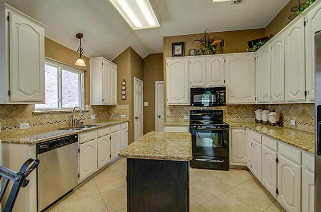light and open with beautiful granite counter tops and white cabinets