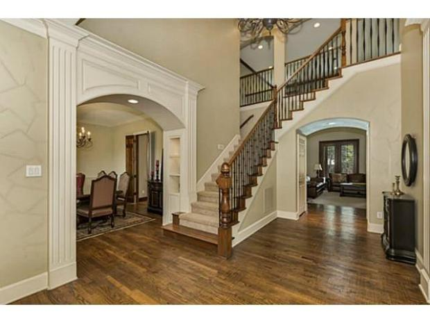 Grand two story entryway, leading to formal living and dining ro
