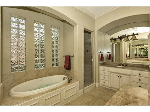 Double sinks, separate shower and bath and decorative lighting