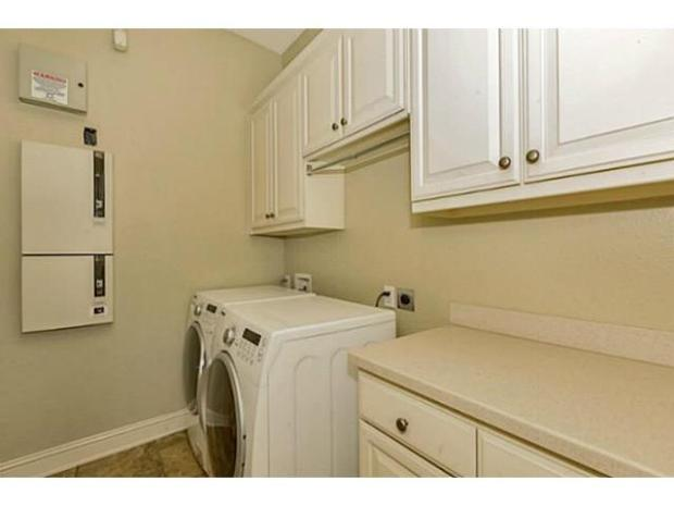 Separate laundry room with gas dryer hookup.  Room for refrigera