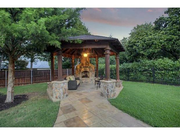 Outdoor living area with fireplace is a great place to unwind.