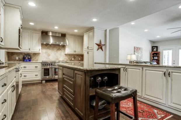 Completely remodeled kitchen with new hardwood custom cabinets,