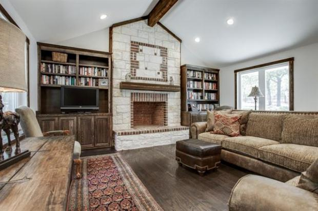Library or living area. Gorgeous stone and brick fireplace, buil