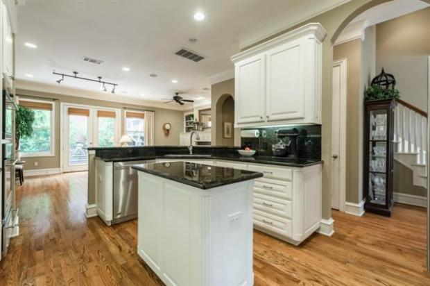 Modern Chef Kitchen with white cabinets, granite & upgraded stai