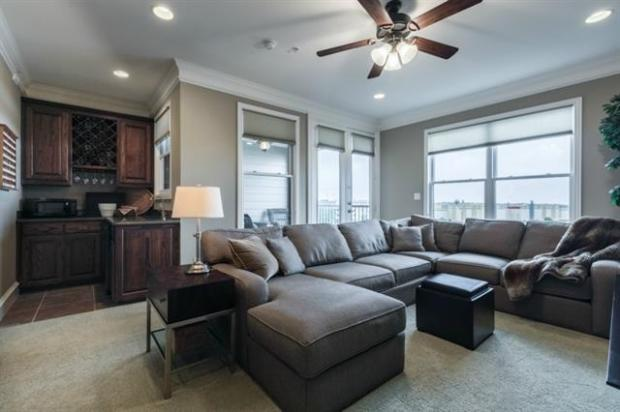 Spectacular Living Room with Wet Bar and Balcony Located on Leve