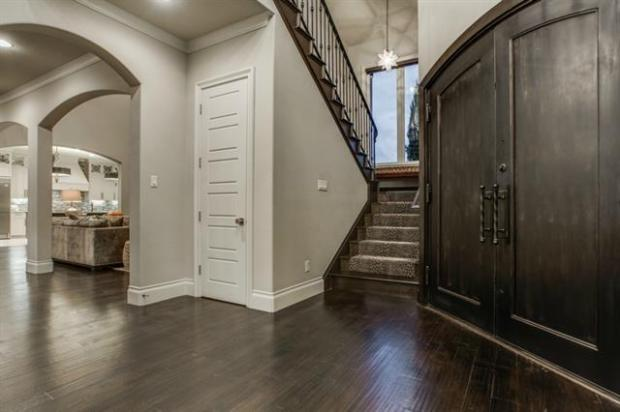 Entry with Arched Openings and Wood Floors.