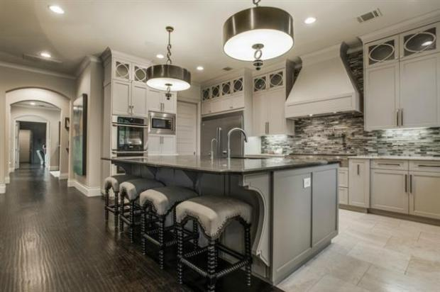 Kitchen Island with Cabinets to the Ceiling and a View of the En