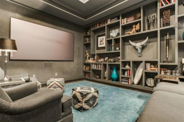 Media Room with 115 Inch Screen, Tray Ceiling and Wall of Built-