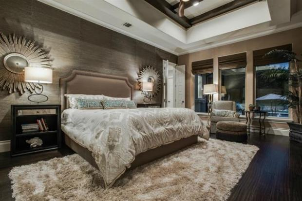 Master Bedroom with Grass Cloth Walls, Wood Floors and a View of