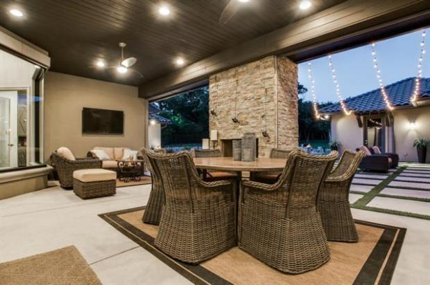 Covered Patio Area with Fireplace and Phantom Screens.