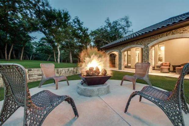 Sitting Area with Fire Pit Adjacent to the Guest House Covered P