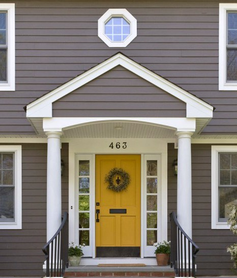 golden-yelloow-front-door-on-a-dark-gray-or-taupe-house-is-beautiful